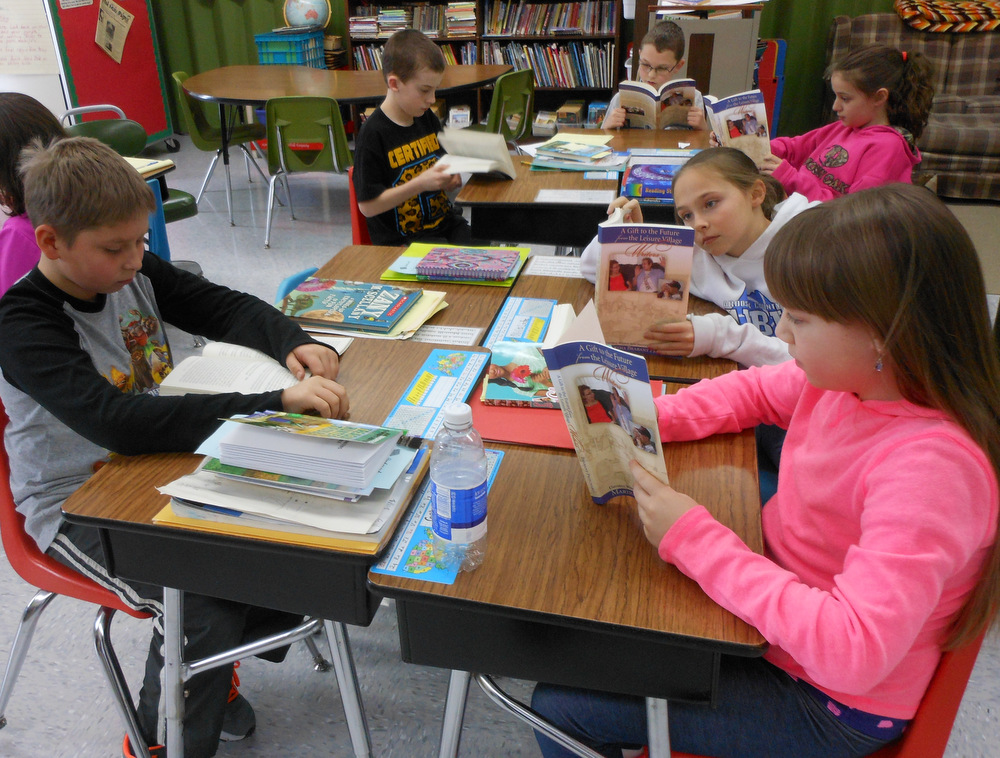 Students learning about history from local Elders' writings