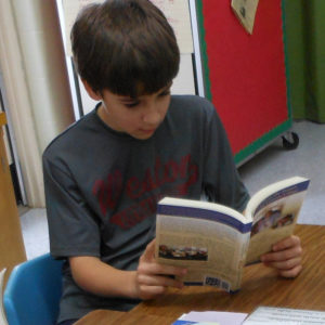 Student reading about A GIFT TO THE FUTURE